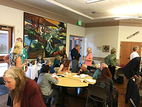 Attendees sharing info at a recent BAIPA meeting